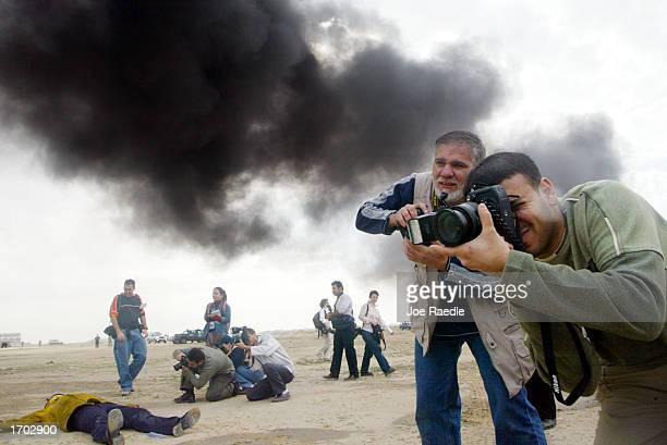 Journalists document a Civil Defense Authority mock chemical attack December 28, 2002 in Kuwait City, Kuwait. The Civil Defense Center continues to...