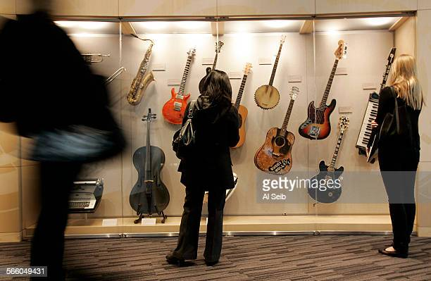 Journalists enjoy the new Grammy Museum Tuesday during a media–preview tour testing the hands–on exhibits featured in the multi–level shrine located...