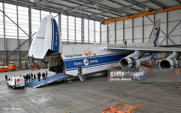 Journalists enter an Antonov AN124 the world's largest freight plane photographed during a press conference held in the plane during the Intec and Z...