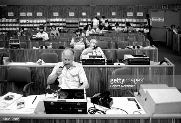 Journalists file stories in the media center at Kennedy Space Center prior to the launch of the Space Shuttle Challenger on June 18 1983 STS7 was...