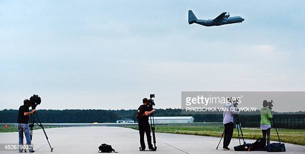 Journalists film a Hercules C130 transport plane of the Royal Dutch Airforce taking off on Eindhoven Airbase, the Netherlands, with 40 members of the...