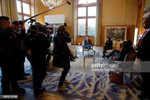 Journalists film and take pictures of mayor of Paris Anne Hidalgo meeting Canadian Prime Minister Justin Trudeau as part of the GovTech Summit, at...
