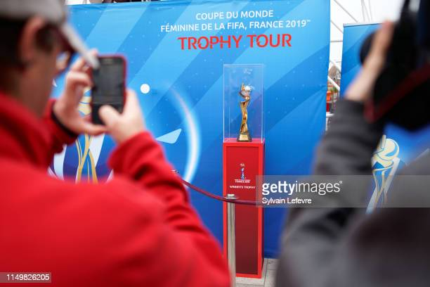 Journalists film FIFA Women's World Cup France 2019 Trophy during the Valenciennes stopover of National Trophy Tour on May 17 2019 in Valenciennes...