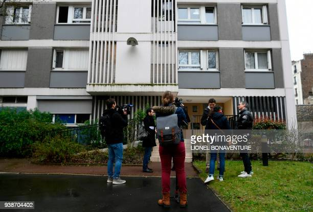 Journalists film outside the building of the apartment of Mireille Knoll in Paris on March 27 after she was found dead in her apartment on March 23...