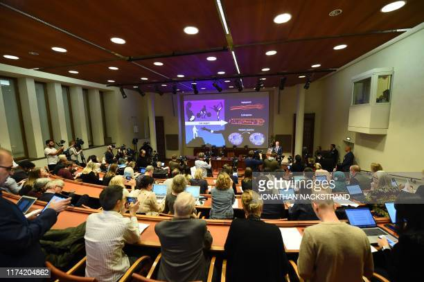 Journalists follow the announcement of the 2019 Nobel Prize in Physiology or Medicine during a press conference at the Karolinska Institute in...