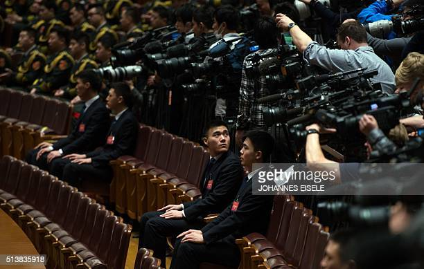 Journalists follow the speech of Chinese Premier Li Keqiang during the opening ceremony of the National People's Congress in the Great Hall of the...