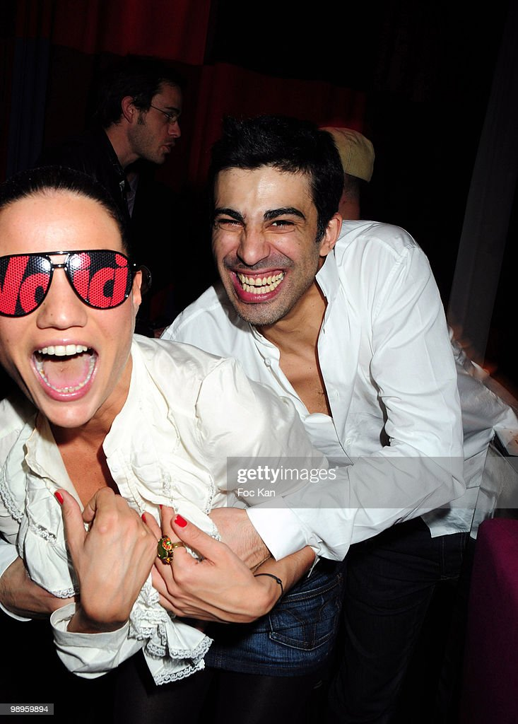 TV journalists Francesca Antoniotti from Canal Plus Sport and Miko (Michael Cyril Elie Simeoni) from Virgin 17 attend the Miko and Pacman 'Lucky Star DJ Set Party' at the Hotel Murano on March 25, 2010 in Paris, France.