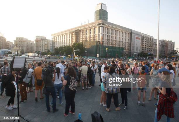 Journalists gather and drink champagne as they rejoice at the news that their colleague Arkady Babchenko is not killed at Independence Square in Kiev...