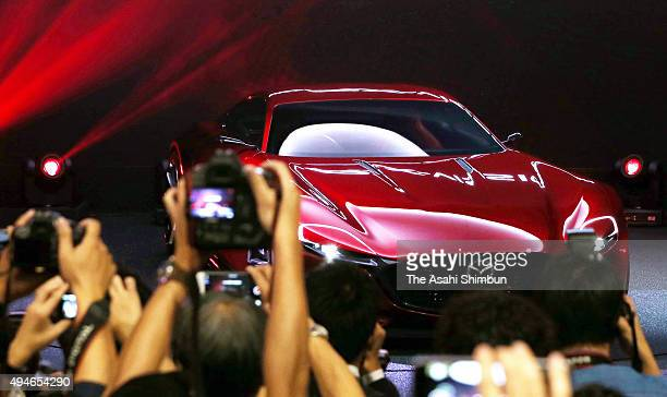 Journalists gather around Mazda Motor Co's RXVision during the Tokyo Motor Show at Tokyo Big Sight on October 28 2015 in Tokyo Japan 160 companies...