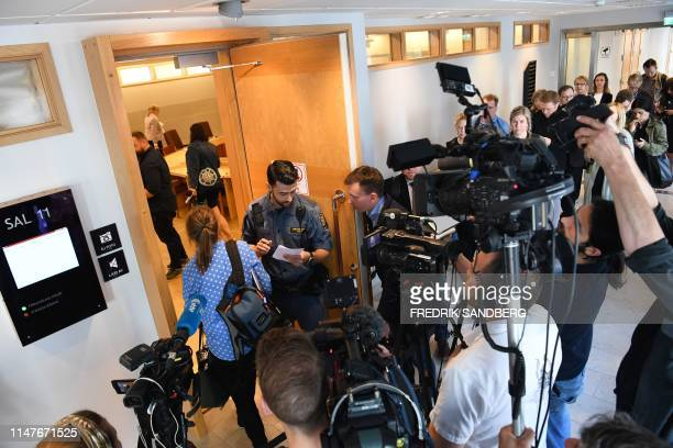 Journalists gather at the Uppsala Dictrict Court in Sweden where the the detention hearing in the Julian Assange case is taking place on Monday June...