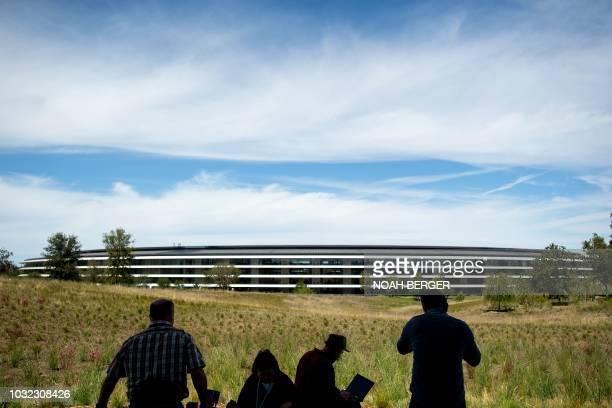 Journalists gather for a product launch event at Apple headquarters in Cupertino, California, on September 12, 2018. - New iPhones set to be unveiled...