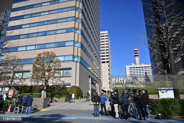 Journalists gather in front of the Tokyo public prosecutors office building in Tokyo on April 4 following the rearrest of Former Nissan chief Carlos...