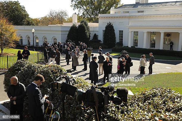 Journalists gather on the driveway in front of the West Wing in anticipation of the arrival of PresidentElect Donald Trump at the White House...