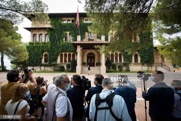 Journalists gather outside the royal family's summer residence at the Marivent Palace in Palma de Mallorca ahead of a meeting between the Spanish...