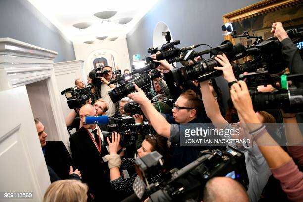 Journalists gather upon the arrival of Catalonia's sacked president for a meeting with Danish MP and representative of the Faroese separatist party...