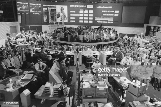 Journalists gathered in the Studio 1 at BBC Television Centre for the 'BBC Election Night Broadcast' among them in the central table are Alastair...