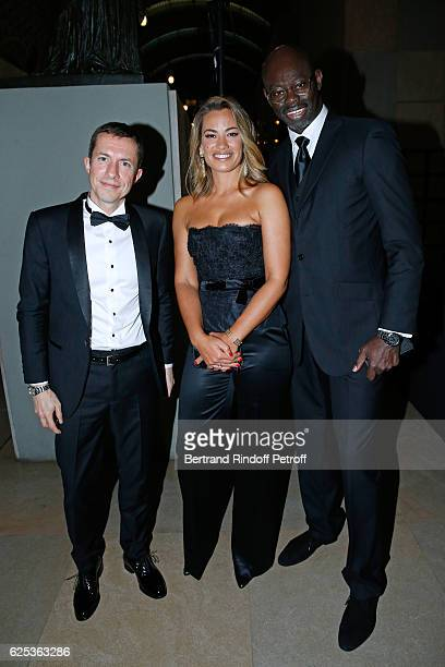 Journalists Gregoire Margotton AnneLaure Bonnet and CEO of Sport Democratie SylvereHenri Cisse attend the GQ Men of the Year Awards 2016 Photocall at...