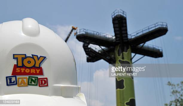 A journalist's hard hat is seen near one of the Toy Story Land attraction site main ride during its launch in Hong Kong September 8 2011 Hong Kong...