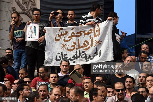 Journalists hold a banner reading in Arabic 'I am a journalist not a terrorist' during a demonstration outside the Journalist Syndicate headquarters...