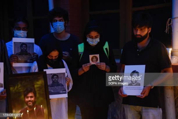 Journalists hold portraits of Danish Siddiqui during a candle light vigil in Srinagar. Reuters journalist Danish Siddiqui was killed on Friday while...