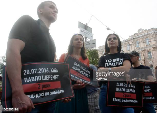 Journalists hold posters reading quot Kiev Pavlo Sheremet 2 years killers still not found' as they stand at the site in central Kiev where journalist...