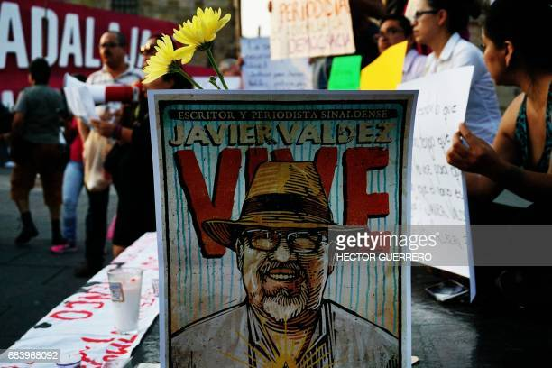 Journalists hold signs condemning violence against journalists while protesting the recent murder of the of Mexican journalist Javier Valdez on May...