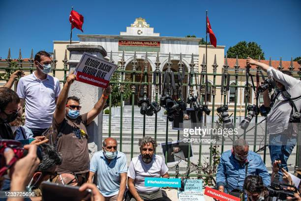 Journalists hung their cameras on the bars of the Istanbul Governor's Office and protested the police violence with banners saying free press, free...