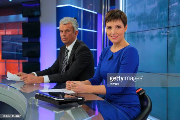 journalists in a tv news studio - newscaster stock pictures, royalty-free photos & images