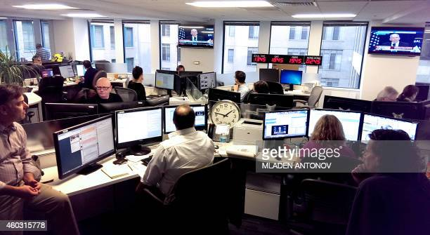 Journalists in the Agence FrancePresse newsroom in Washington DC watch the unprecedented livebroadcast press conference given by the US Central...