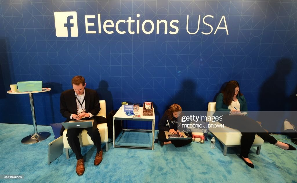 Journalists in the Facebook section take notes ahead of the Democratic presidential debate at the Wynn Hotel in Las Vegas, Nevada on October 13, 2015, hours before the first Democratic Presidential Debate. After ignoring her chief rival for months, White House heavyweight contender Hillary Clinton steps into the ring Tuesday to confront independent Senator Bernie Sanders in their first Democratic debate of the 2016 primary cycle. Clinton will take center stage in Las Vegas joined by Sanders and three other hopefuls, and while there is unlikely to be a dramatic clash of personalities as seen in the first two Republican debates, the spotlight is likely to be on the top two candidates. The other three challengers -- former Maryland governor Martin O'Malley, ex-senator Jim Webb and former Rhode Island governor Lincoln Chafee -- will try to generate breakout moments to show they are electable alternatives to Clinton.