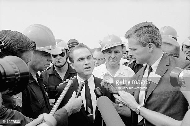 Journalists interview Alabama Governor George Wallace during his attempts to block integration of the state schools