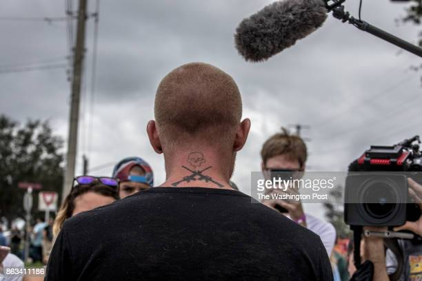 Journalists interview an alt-right identifying man who came to see Richard Spencer, October 19 at the University of Florida, in Gainesville, Florida.