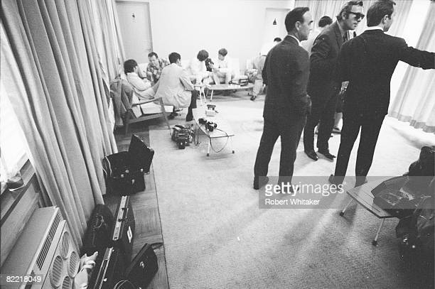 Journalists interview John Lennon and George Harrison in the VIP lounge at Kaitak Airport Hong Kong as the Beatles wait for a connecting flight to...