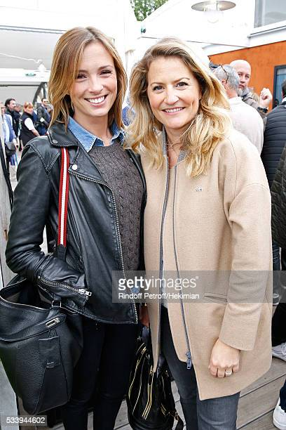 Journalists Isabelle Ithurburu and Astrid Bard attend the 2016 French Tennis Open Day Three at Roland Garros on May 24 2016 in Paris France