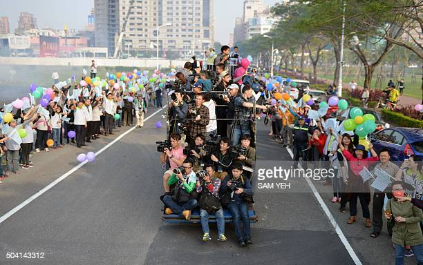 Journalists jam a truck to catch images of Tsai Ingwen presidential candidate for Taiwan's main opposition Democratic Progressive Party during an...