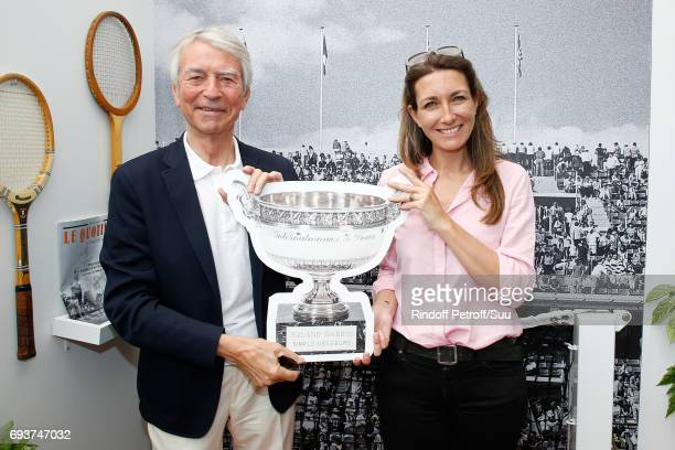 Journalists JeanClaude Narcy and AnneClaire Coudray pose at 'Moet et Chandon' during the 2017 French Tennis Open Day Twelve at Roland Garros on June...
