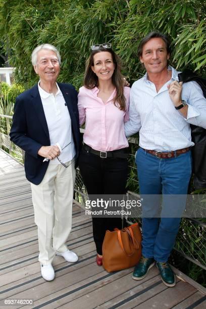 Journalists JeanClaude Narcy AnneClaire Coudray and her companion Nicolas Vix attend the 2017 French Tennis Open Day Twelve at Roland Garros on June...