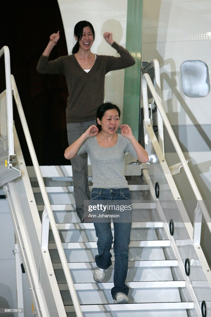Journalists Laura Ling and Euna Lee arrive at Hangar 25 on August 5, 2009 in Burbank, California after being released by North Korean authorities yesterday. Ling and Lee, of San Francisco based Current TV, were both arrested by North Korea in March for illegally entering the country on the Chinese border. Yesterday they were pardoned by President Kim Jong-Il after a meeting with former U.S. President Bill Clinton. Ling and Lee had been sentenced to 12 years in prison in June.
