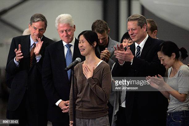 Journalists Laura Ling speaks in front of Euna Lee former Vice President Al Gore and former President Bill Clinton after Ling and Euna Lee arrive at...