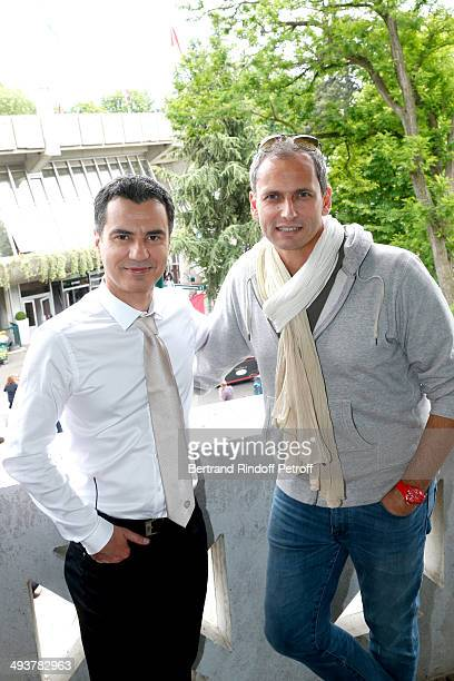 Journalists Laurent Luyat and Louis Laforge attend the French Open 2014 Day 1 at Roland Garros on May 25 2014 in Paris France
