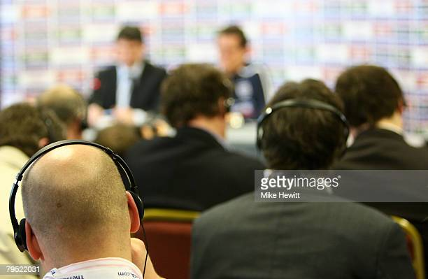 Journalists listen through translation headsets to England manager Fabio Capello during an official press conference prior to England's friendly...