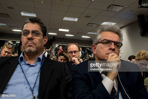 Journalists listen to Foreign Minister of Russia Sergey Lavrov and US Secretary of State John Kerry speak at a news conference after a United Nations...