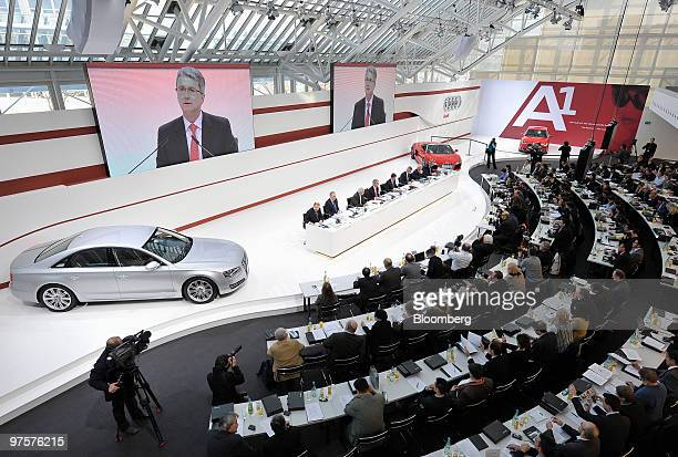Journalists listen to Rupert Stadler chief executive officer of Audi AG as he speaks at the company's full year earnings press conference in...