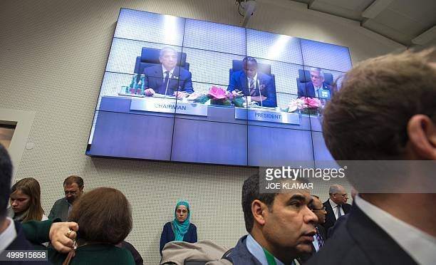 Journalists listen to the opening speech of Nigeria's Minister of State for Petroleum Resources and President of the OPEC Conference Emmanuel Ibe...
