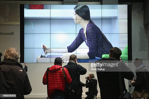 Journalists look at a multimedia presentation hall in the new Microsoft Berlin center on November 5 2013 in Berlin Germany The Microsoft Berlin...