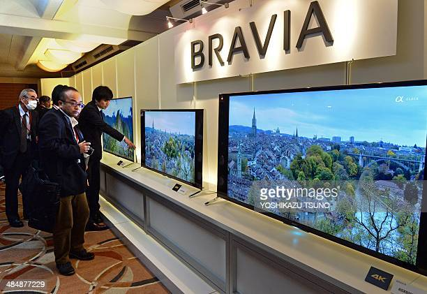 Journalists look at Japanese electronics maker Sony's new 4K television set line up at a press preview in Tokyo on April 15 2014 Sony controlled more...