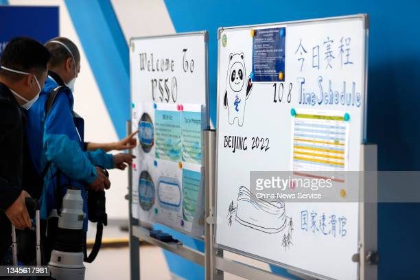 Journalists look at match information on day one of the Speed Skating China Open, a test event of the 2022 Beijing Winter Olympic Games, at the...