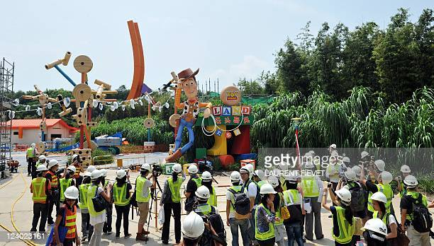 Journalists look at the Toy Story Land attraction site main entrance during its launch in Hong Kong September 8 2011 Hong Kong Disneyland which has...