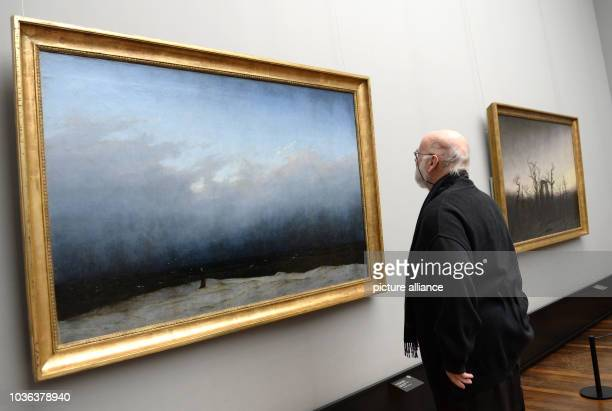 A journalists looks at the masterpieces 'The Monk by the Sea' and 'The Abbey in the Oakwood' by painter Caspar David Friedrich in the Alte...