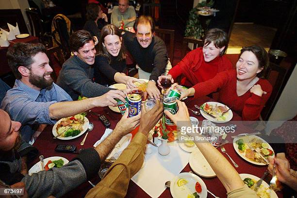 Journalists make a Thanksgiving toast at the UN Club November 22, 2001 in Islamabad, Pakistan. Some of the international media representatives from...